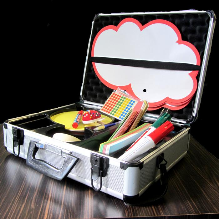 A metal presentation case with filing cards, pens, stickers and pins.